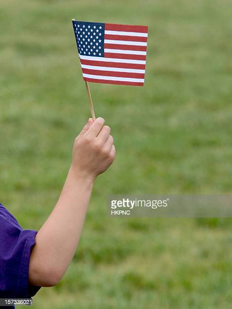 Child With Miniature Patriotic American Flag