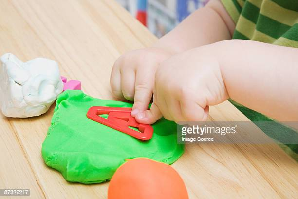 child with modelling clay - clay stock pictures, royalty-free photos & images