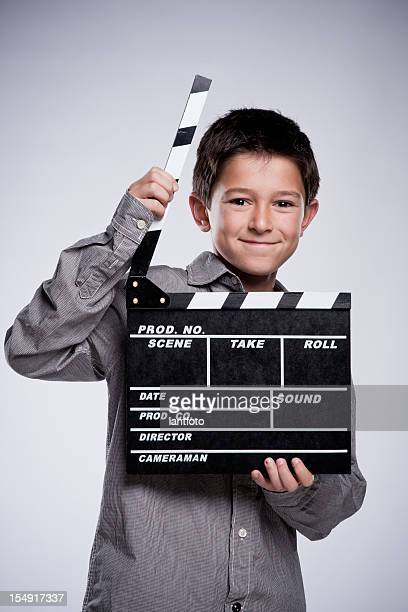 Child with movie clapper board.