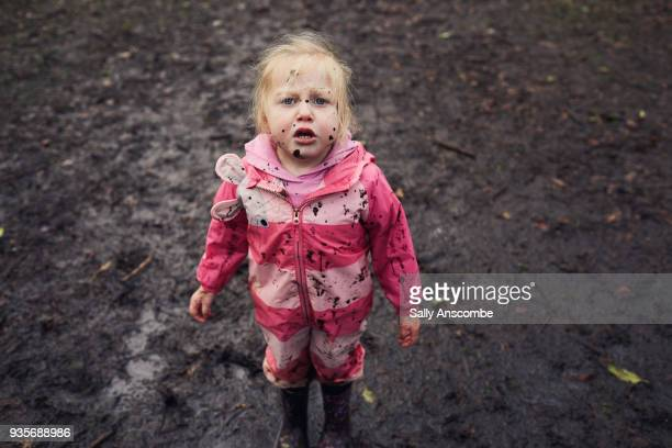 Child with mud on her face