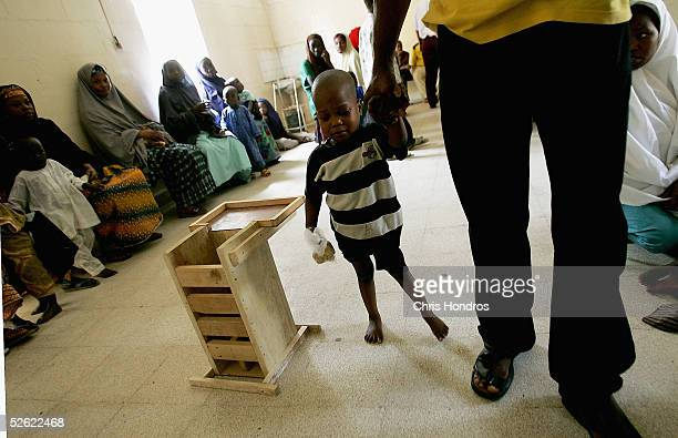 A child with polio is led to treatment at the Murtala Muhammed Public Hospital April 13 2005 in Kano Nigeria Polio a disease that health workers once...