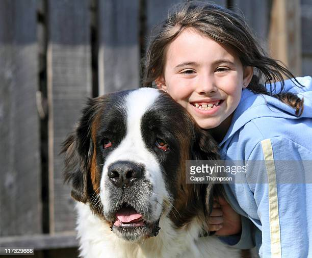 Child with saint bernard dog