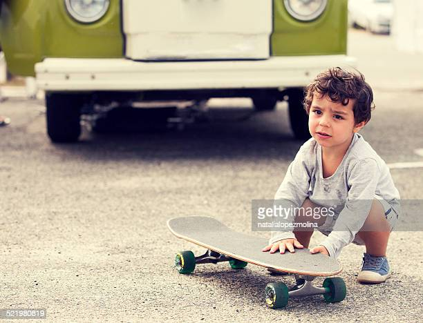 Child with skateboard and van