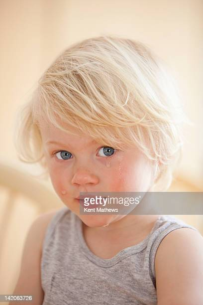 child with tears running down face