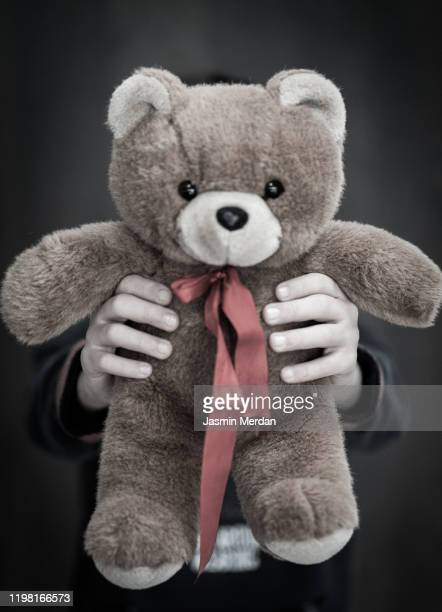 child with teddy bear - teddy bear stock pictures, royalty-free photos & images