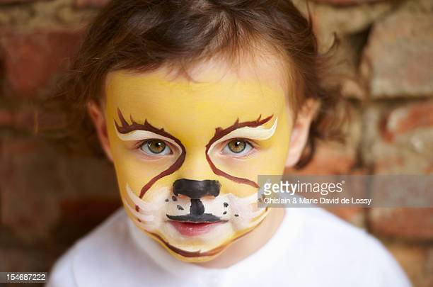 Child with tiger make up