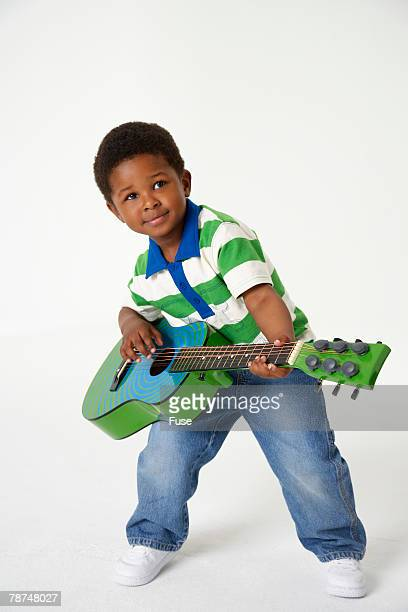 Child With Toy Guitar
