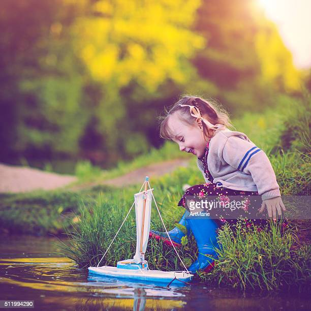 Child with toy ship