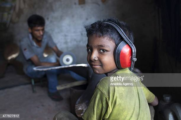 A child worker is seen on duty at the shipyard near Dhaka on June 17 2015 Child labor problem is not a new issue in Bangladesh Poverty leads many...