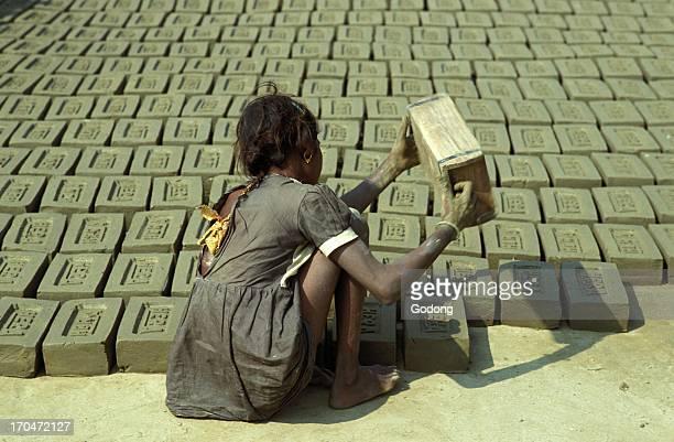 Child worker making bricks India