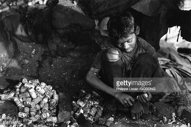 Child Worker Reclaiming Metals from Used Batteries