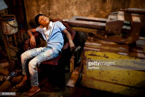 Child worker sleep in workshop in a dockyard in the side of Buriganga River at Dhaka August 2 2017 The laborers work in the dockyard without proper...