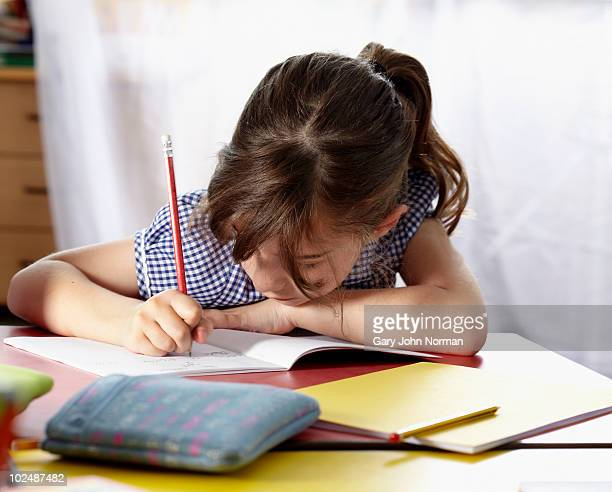 child working in lesson at school. - schoolgirl stock pictures, royalty-free photos & images