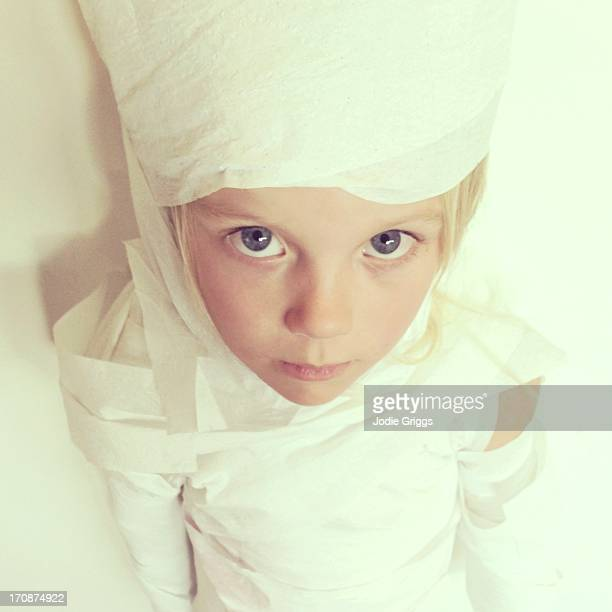 child wrapped in toilet paper like egyptian mummy - wrapped in toilet paper stock pictures, royalty-free photos & images