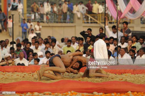 Child wrestlers fight during Wrestling Title Championship at Gari Chaukhandi village on October 27 2014 in Noida India Thousands of wrestlers...
