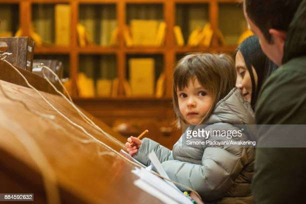 A child writes a Christmas letter in the house of Santa Claus in the Reggia of Venaria on December 2 2017 in Turin Italy