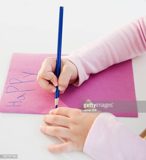 child writing a birthday card - birthday card stock photos and pictures