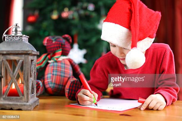 Child Writing a Christmas Letter to Santa Claus