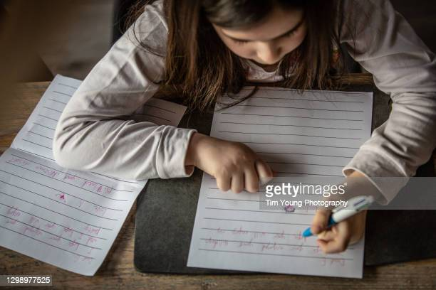 child writing letters to her friends - monogram stock pictures, royalty-free photos & images