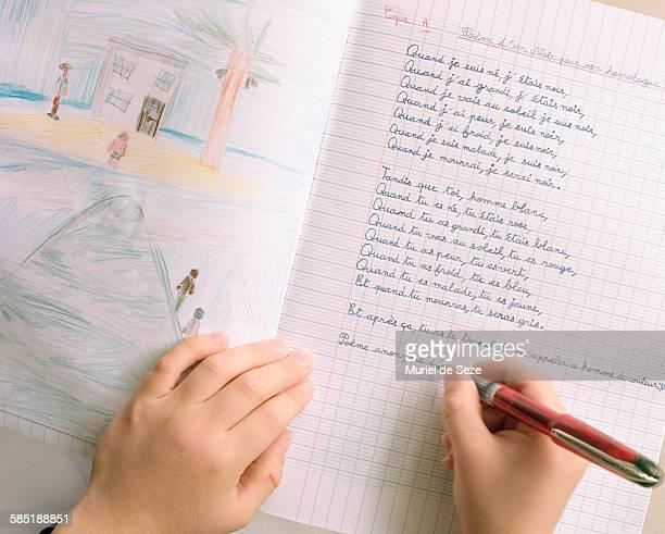 Child writing poem