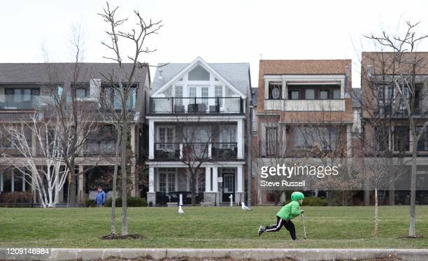 Child zooms past at Woodbine Park as Toronto deals with the third week of self-isolation to try to slow the spread of COVID-19 in Toronto. April 4,...