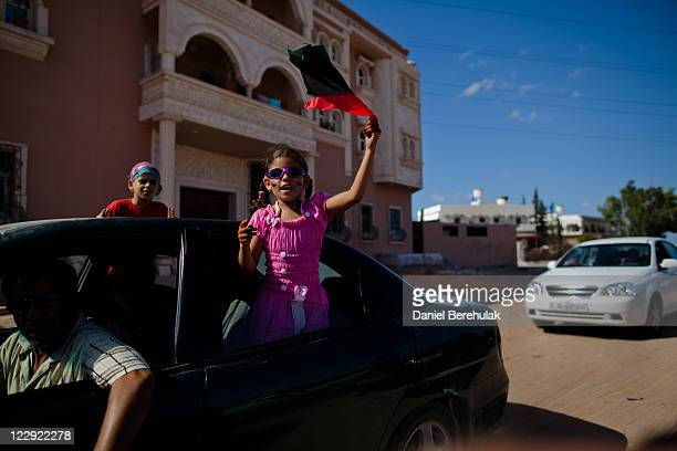 Childen celebrate near to the Khamis Brigade HQ on August 29, 2011 in Tripoli, Libya. Whilst the rebels to seem to be in control of the capital, life...