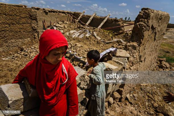 Childen inspect a home destroyed by an airstrike near their own homes that were destroyed in the fighting between government forces and the Taliban...