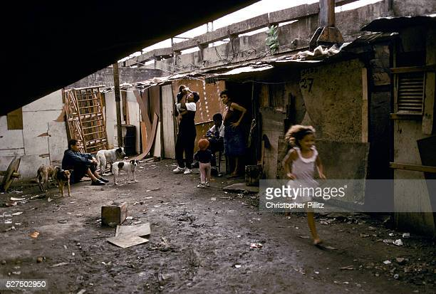 Childen play amidst the squalor of their slumb which lies under a Rio de Janeiro city overpass close to the world famous Maracana football stadium...