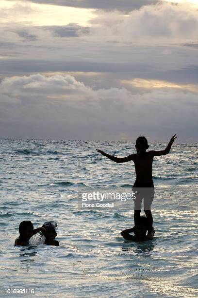 Childen play in the lagoon as the sun goes down on August 15 2018 in Funafuti Tuvalu The small South Pacific island nation of Tuvalu is striving to...