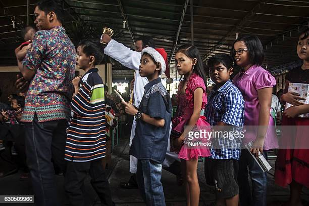 Childern waiting to receive a gift f when attend mass in celebration of Christmas in Sacred Heart of Jesus Catholic Church in Yogyakarta Indonesia on...