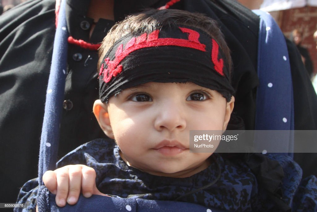 Childerns attends the prossesion to express their devotion during the 9th Ashura Procession of holy mont of Muharram in lahore Pakistan September...