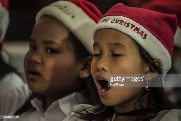 Childerns sing a song when attend mass in celebration of Christmas in Sacred Heart of Jesus Catholic Church in Yogyakarta Indonesia on December 25...