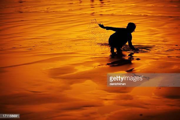 childhood at beach, clifton, karachi - pakistan - pakistan girl stock photos and pictures