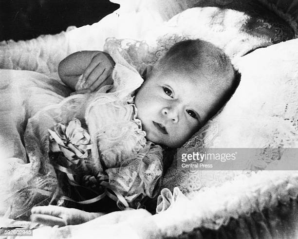 Childhood portrait of the baby Prince Charles in his basket at Buckingham Palace London January 1949
