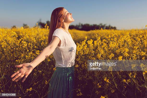 childish heart - redhead girl stock photos and pictures