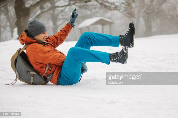 childish man having fun on snow - comedian stock pictures, royalty-free photos & images