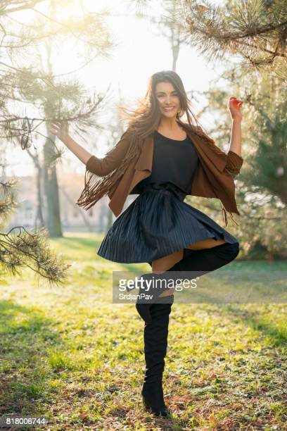 child-like joy - leather skirt stock pictures, royalty-free photos & images