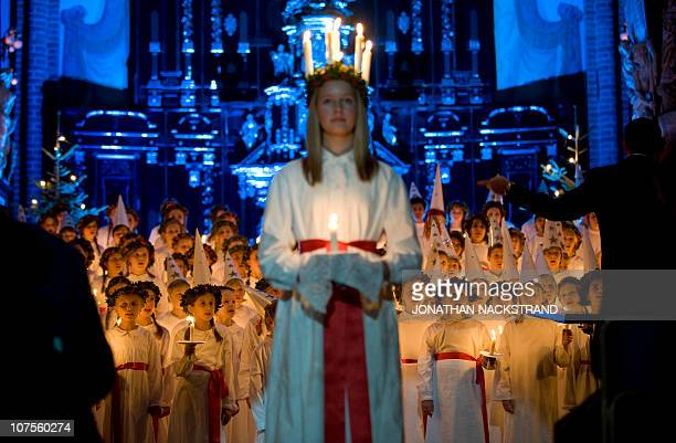 180 children 4th and 6th grade students from the Adolf Fredrik music school take part in an evening Lucia concert that drew 1200 spectators at the...