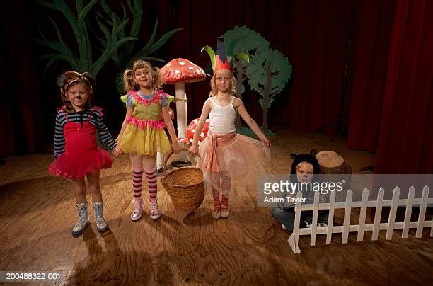 children (5-7) acting on stage, portrait - school play stock photos and pictures