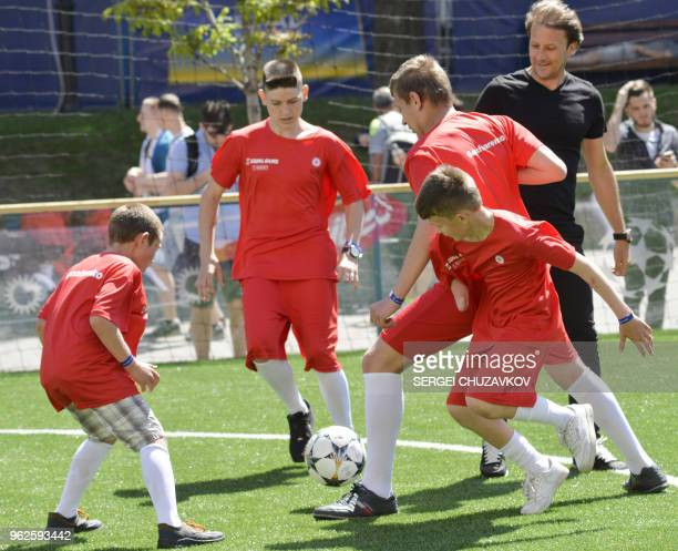 Children affected by mines in the wartorn Ukrainian east play football in a fan zone in central Kiev on May 26 2018 ahead of the 2018 UEFA Champions...