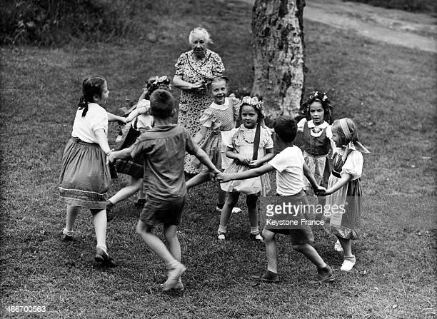 Children aged 6 to 16 playing ring around the rosy with some wearing Russian folk costume on May 14 1944 in United States