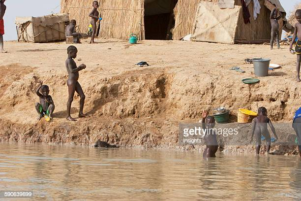 Children along the shores of the Niger River between Mopti and Lake Debo Mali