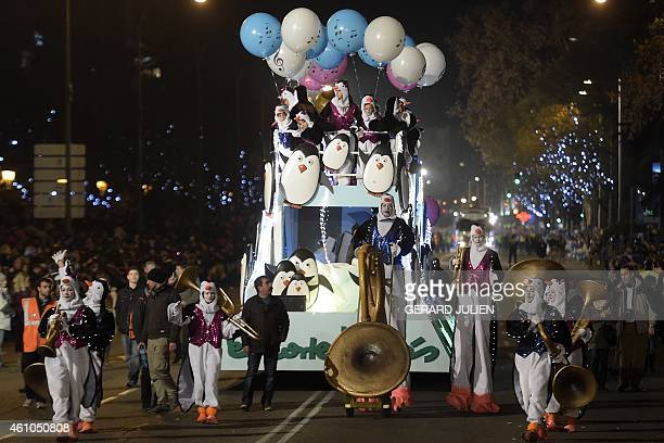 Children and adults disguised as auks stand on a float during the Three Kings parade in Madrid on January 5 2015 Every year on January 5 children and...