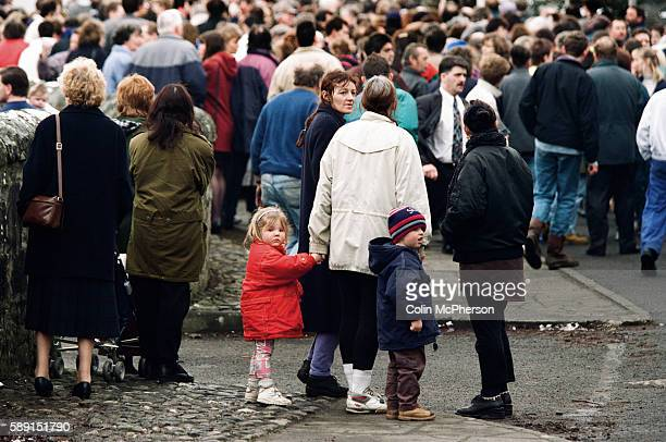 Children and adults gather outside Dunblane primary school Scotland shortly after the shooting incident on the premises The Dunblane school massacre...