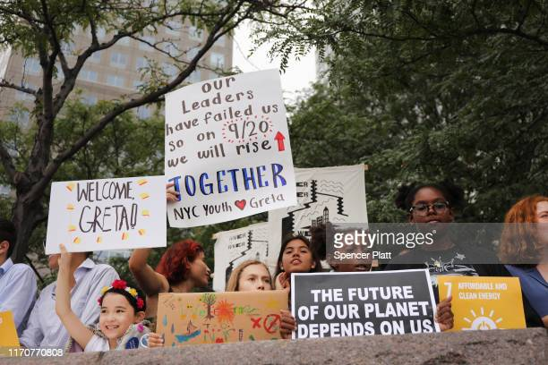 Children and adults wait for the arrival of teenage climate activist Greta Thunberg into New York City after crossing the Atlantic in a sailboat on...