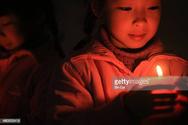 children and candles - candle of hope stock pictures, royalty-free photos & images