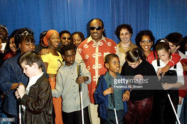 Children and celebrity performers join singer Stevie Wonder on stage during press conference for Stevie Wonder's 6th Annual House Full of Toys...