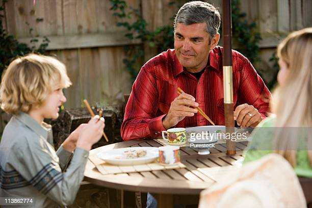 Children and father eating sushi