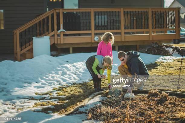 Children and Father examining garden