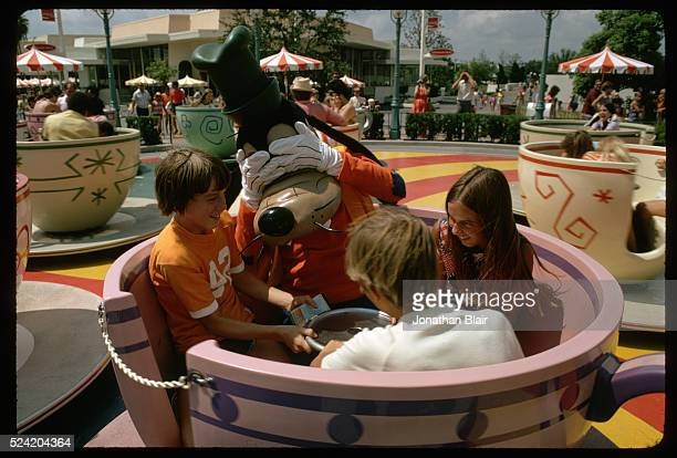 Children and Goofy on Mad Tea Party Ride